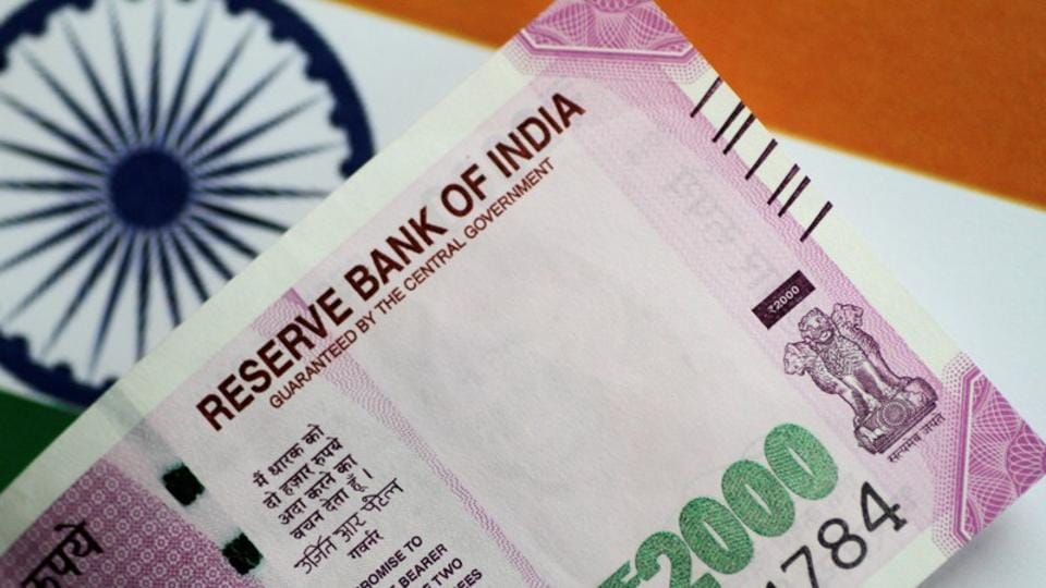 Rupee settles 13 paise higher at 71.85 against USD amid easing crude oil prices
