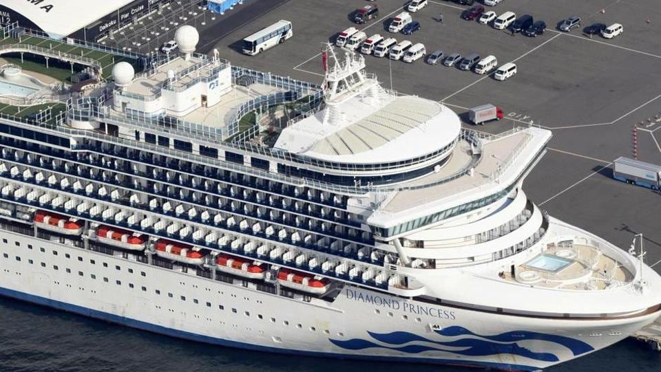The US-operated Diamond Princess is anchored as emergency vehicles stand by at Yokohama Port, near Tokyo, Wednesday, Feb. 12, 2020.
