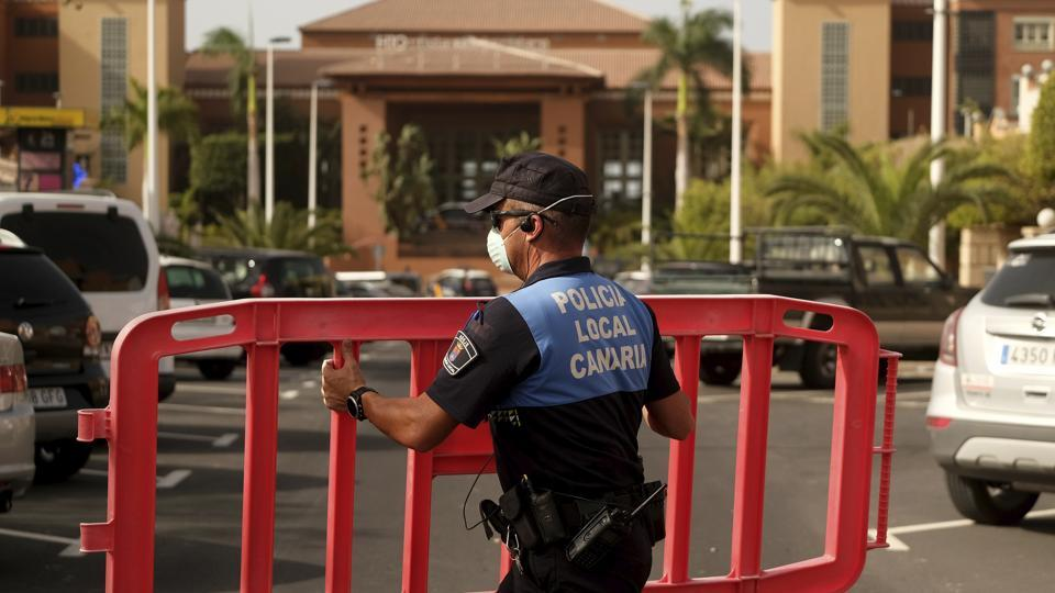 Outside the hotel, which overlooks the sea, a handful of local and national police could be seen standing around wearing masks and purple protective gloves, the entrance cordoned off by plastic tape, footage from one of the hotel guests showed. Feb. 25, 2020