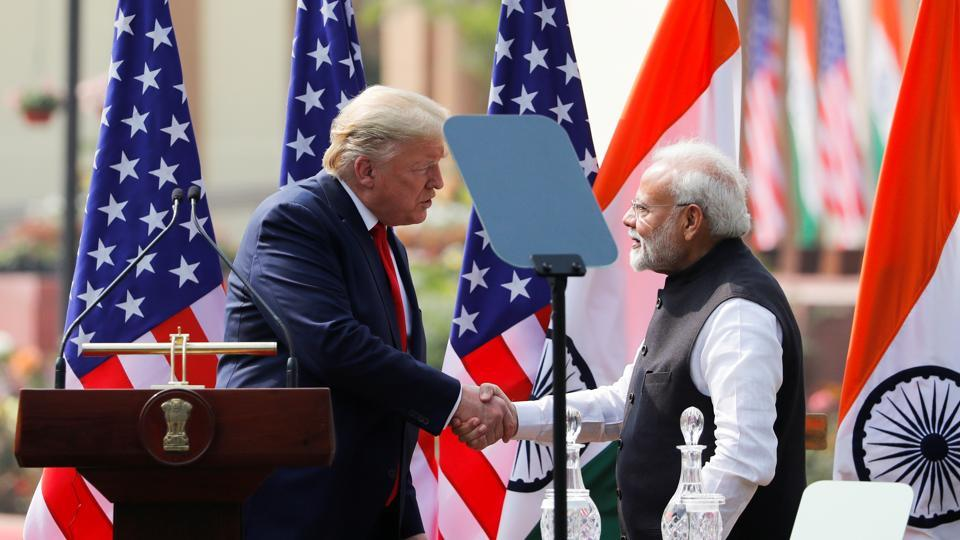 US President Donald Trump and Prime Minister Narendra Modi shake hands during a joint news conference after bilateral talks at Hyderabad House in New Delhi on Tuesday.