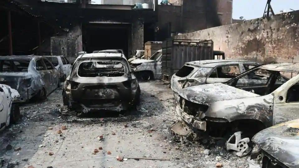 Burnt vehicles after clashes between opposing groups over the Citizenship Amendment Act (CAA) at Karawal Nagar in New Delhi, India, on Wednesday, February 26, 2020.