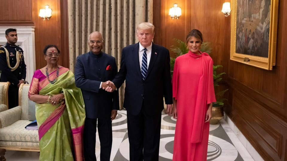 Indian President Ram Nath Kovind and his wife Savita Kovind stand with President Donald Trump and first lady Melania Trump as they arrive for a state banquet at Rashtrapati Bhavan, in New Delhi.