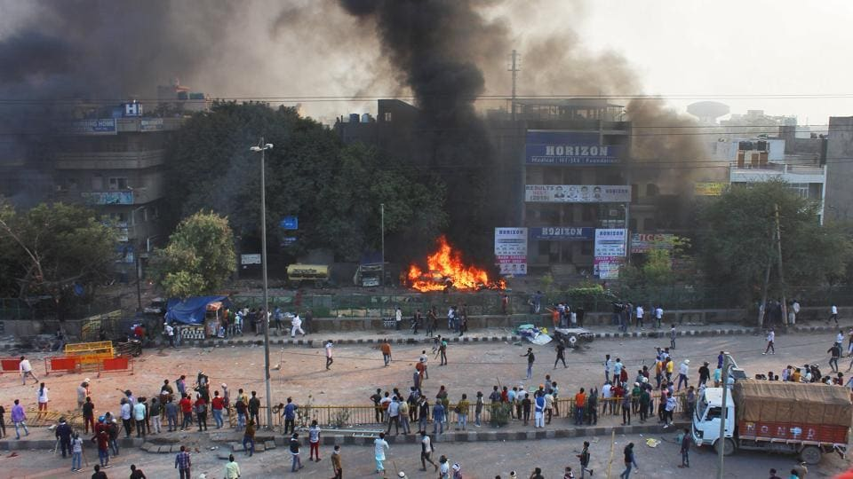 Protesters seen at the site of clashes, at Yamuna Vihar, in New Delhi.