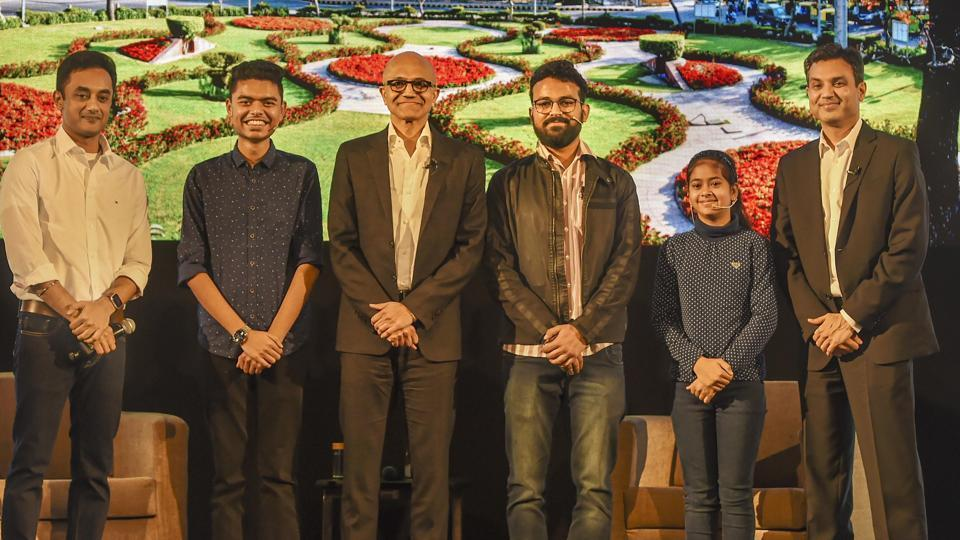 Microsoft CEO Satya Nadella(3rd L) poses for a group photograph with Namya Joshi and other students.