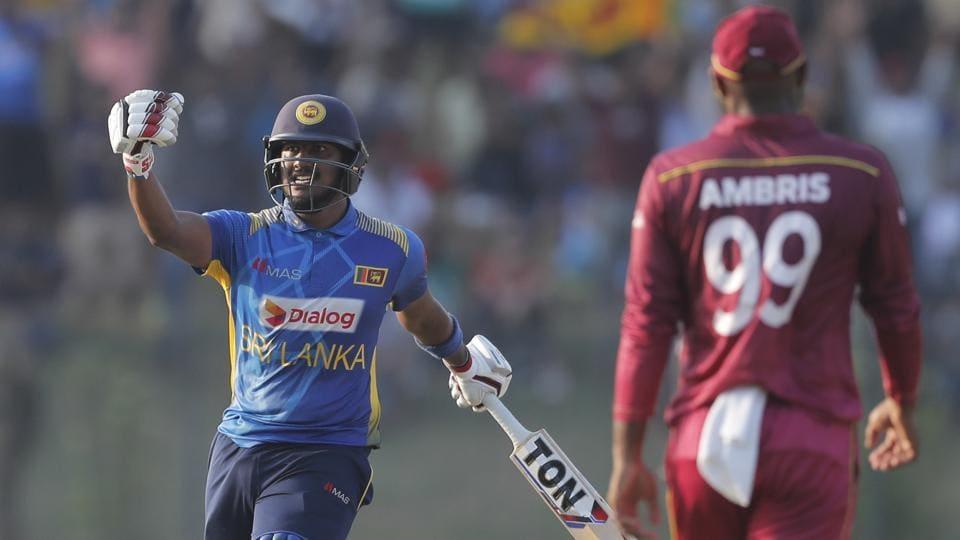 Sri Lanka's Avishka Fernando, left, celebrates his century during the second one day international cricket match between Sri Lanka and West Indies in Sooriyawewa, Sri Lanka, Wednesday, Feb. 26, 2020.