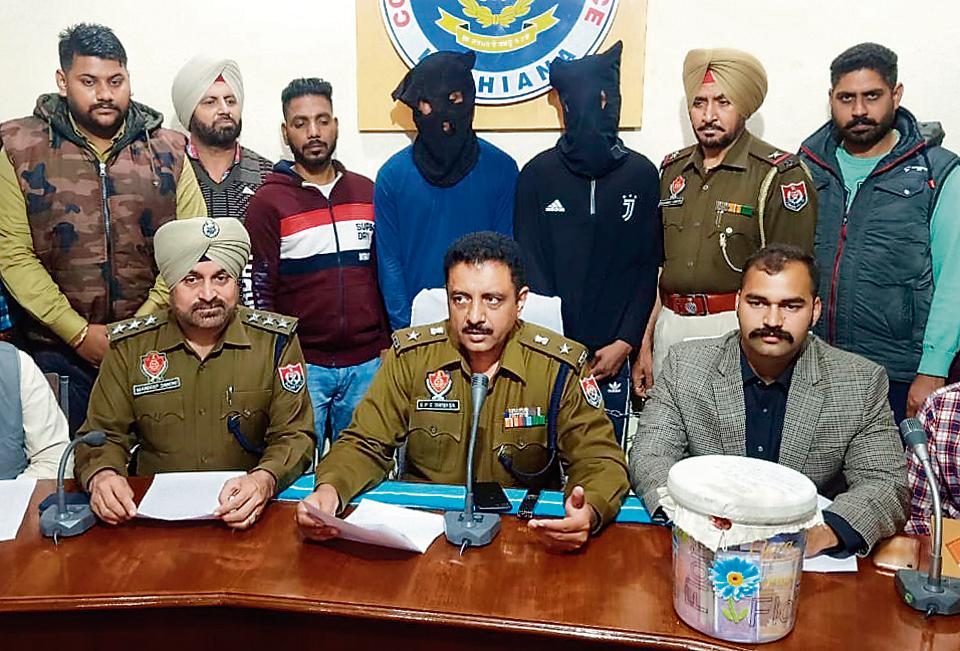 The accused (faces covered) in police custody in Ludhiana on Wednesday.
