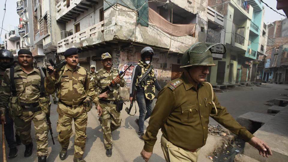 New Delhi, India - Feb.26, 2020: Police and paramilitary personnel on a flag march making their presence known in the area, after clashes between opposing groups over the Citizenship Amendment Act (CAA) at Karawal Nagar in New Delhi.