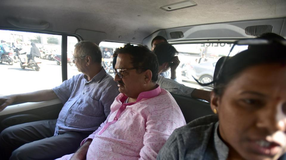 Nationalist Congress Party MLC Anil Bhosale (centre) being taken to Pune court premises by a Pune police team on Wednesday.