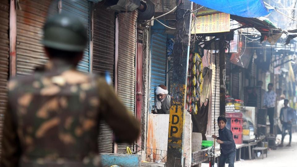 Police personnel patrol streets between Kadam Puri and Yamuna Vihar following violent clashes over the new citizenship law, in New Delhi.