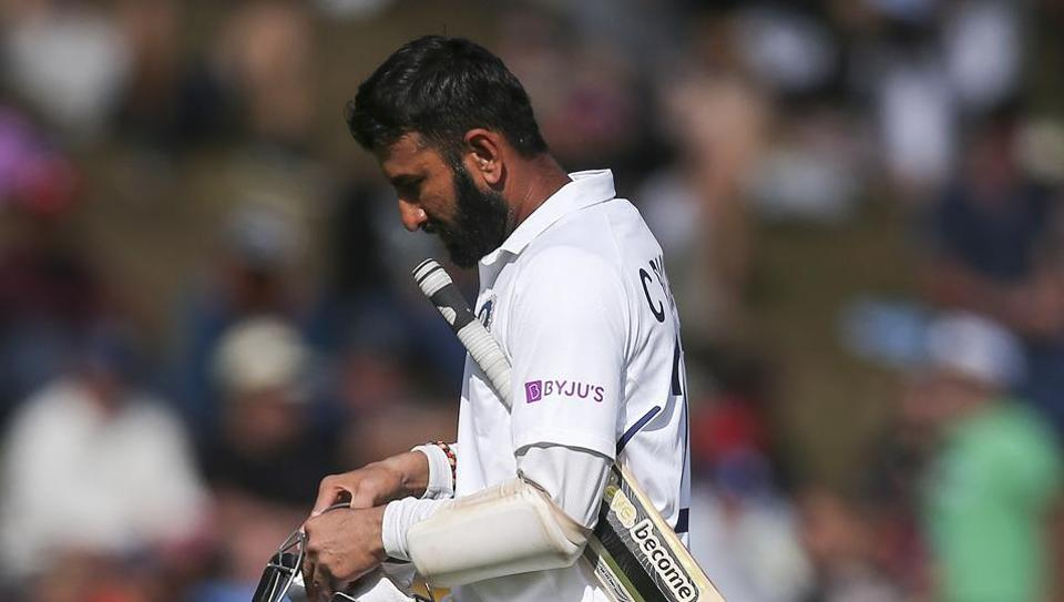 Cheteshwar Pujara of India leaves the field after being dismissed during day three of the First Test match between New Zealand and India