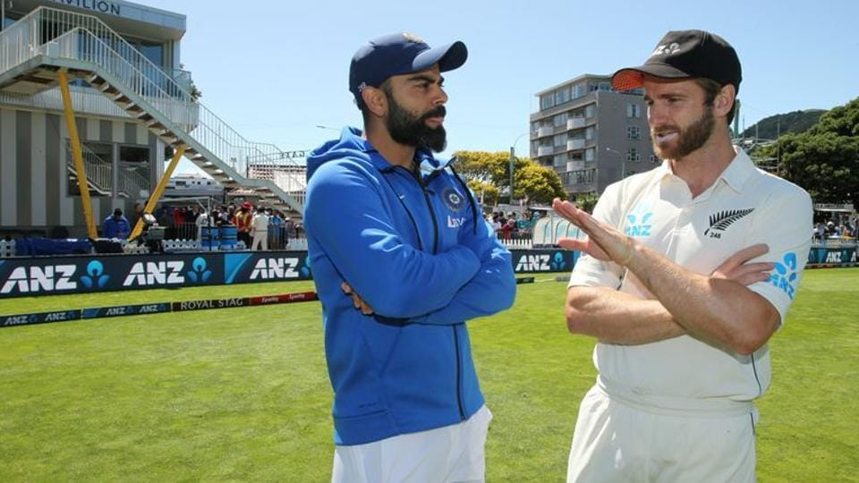 New Zealand's Kane Williamson talks to India's Virat Kohli.