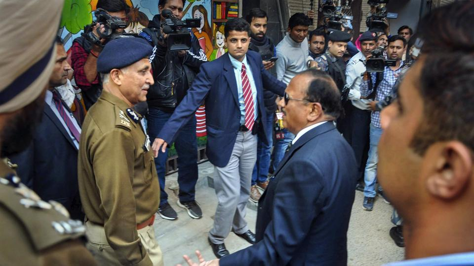 NSA Ajit Doval interacts with Special Commissioner of Police in Delhi SN Srivastava during his visit to the riot affected areas to assess ground situation, in north east Delhi.