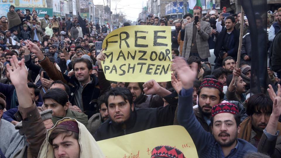 Supporters of Pashtun Tahafuz Movement (PTM) hold signs as they chant slogans during a country-wide protests over the arrest of their leader and student activist Manzoor Pashteen, in Quetta, Pakistan January 28, 2020.