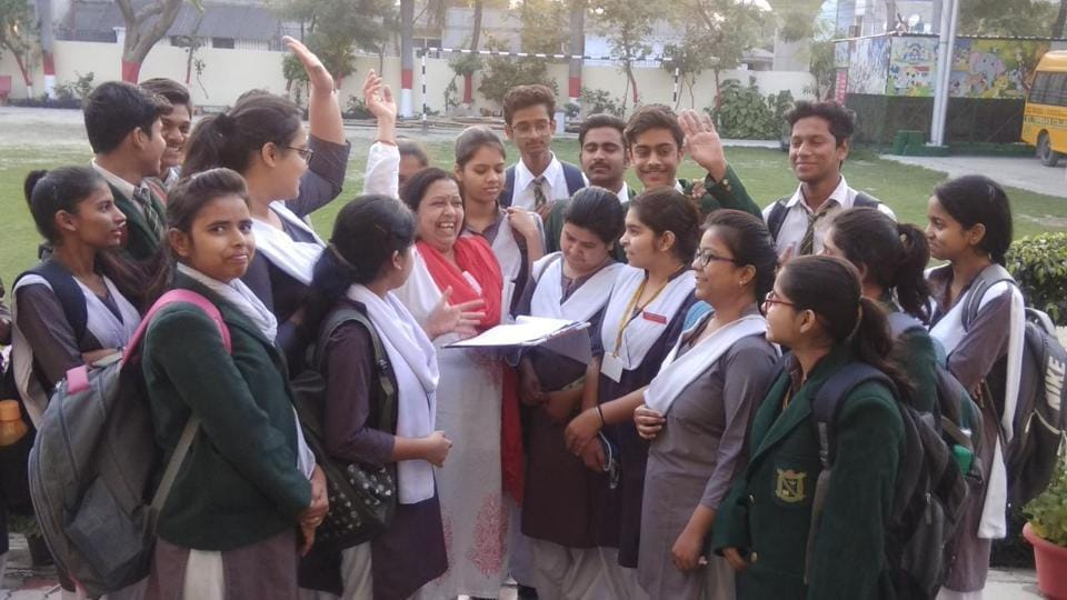 Students of St Teresa College with the school teacher after ISC Hindi paper in Lucknow on Friday.