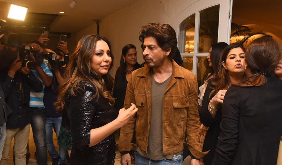 Shah Rukh Khan is the perfect husband as he visits wife Gauri's store, gets clicked with her girl gang. Watch