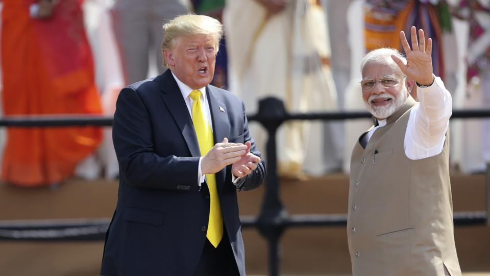 Indian Prime Minister Narendra Modi, right, waves as U.S. President Donald Trump reacts to the crowd during the 'Namaste Trump' event.