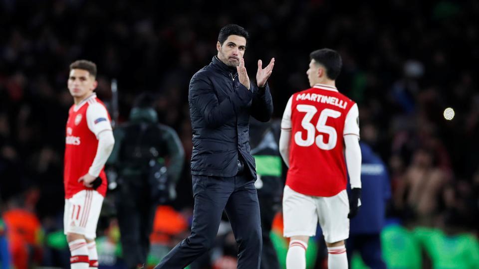 Arsenal manager Mikel Arteta applauds fans after the match.