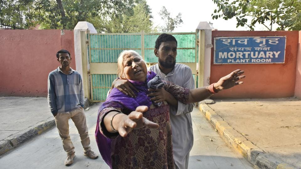 Mother of Mohhmmed Irfan from Mustafabad breaks down as she waits for his body, who was killed who was killed during communal violence in northeast Delhi area over the amended citizenship law, outside GTB hospital mortuary.