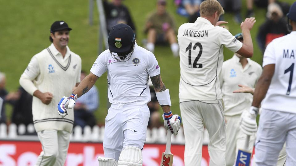 India's Virat Kohli, second left, walks from the field after he was dismissed by New Zealand's Kyle Jamieson.