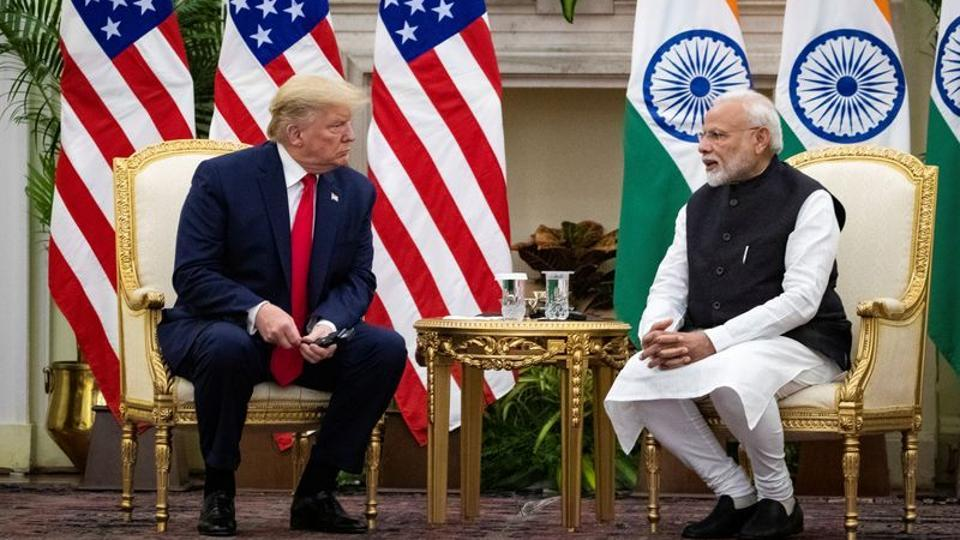 Prime Minister Narendra Modi speaks to US President Donald Trump during a meeting at Hyderabad House in New Delhi.