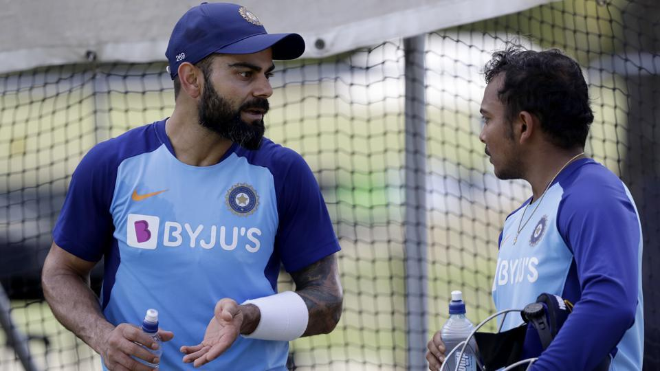 India's Virat Kohli, left, gestures as he talks with teammate India's Prithvi Shaw ahead of the second cricket test against New Zealand in Christchurch, New Zealand, Friday, Feb. 28, 2020.