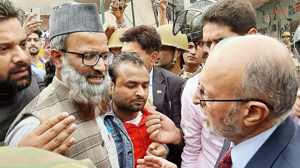 Delhi Lt. Governor Anil Baijal interacts with locals during a visit to the communal violence affected area of Maujpur, in Delhi.
