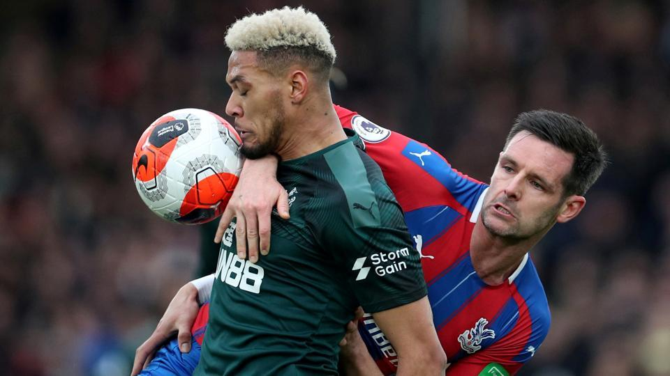 Newcastle United's Joelinton in action with Crystal Palace's Scott Dann.