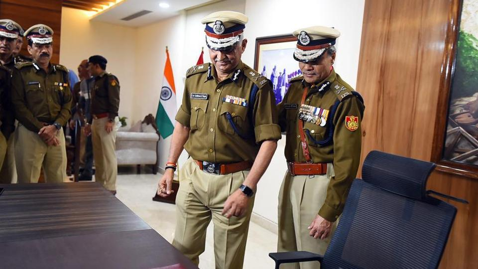 Outgoing Delhi Police Commissioner Amulya Patnaik with Delhi Police Special Commissioner SN Srivastava (L), as the latter takes charge as the new Police Commissioner of Delhi, at Delhi Police Headquarters, Jai Singh road, in New Delhi.