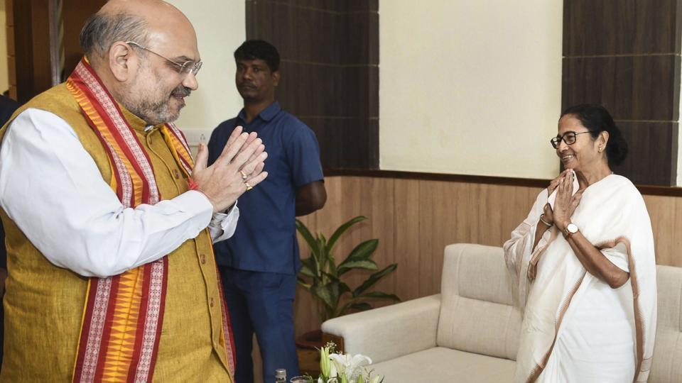 Home Minister Amit Shah greets West Bengal Chief Minister Mamata Banerjee during 24th Eastern Zonal Council meeting, in Bhubaneswar, Friday, Feb. 28, 2020.