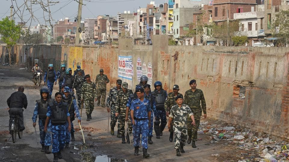 Rapid Action Force (RAF) personnel patrol the lanes at Shiv Vihar, Mustafabad, in New Delhi.