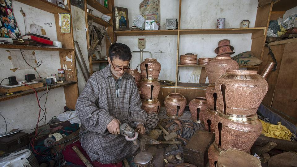 A Kashmiri coppersmith working inside a workshop in the downtown of Srinagar.