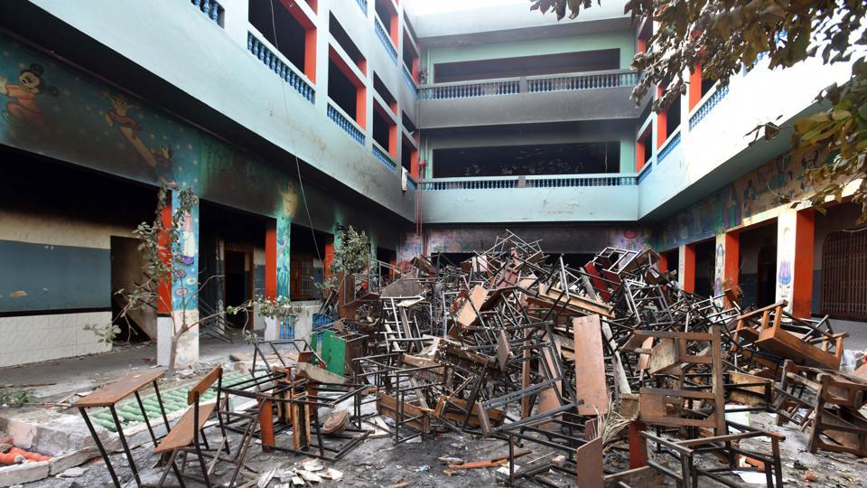 A view of a school following violent clashes over the new citizenship law, at Shiv Vihar, in New Delhi.