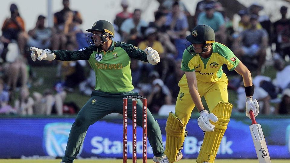 South African wicketkeeper Quinton De Kock, left, points toward the ball while Australian batsman Marnus Labuschagne watches on during the ODI cricket match between South Africa and Australia in Paarl, South Africa, Saturday, Feb. 29, 2020. (AP Photo/Halden Krog)