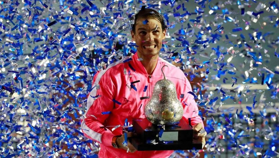 Spain's Rafael Nadal celebrates with the trophy after winning his final match against Taylor Fritz.