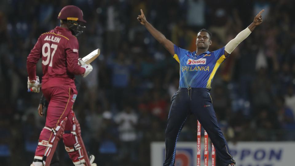 Sri Lanka's Angelo Mathews celebrates the dismissal of West Indies' Fabian Allen.