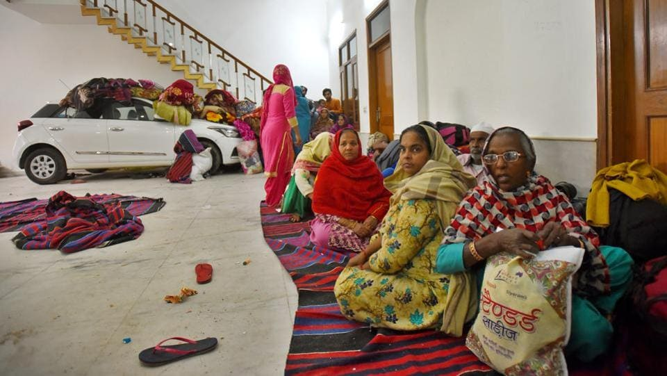 Women rescued during the violence  take shelter inside a house at Shiv Puri on  February 28. (Amal KS / HT Photo)