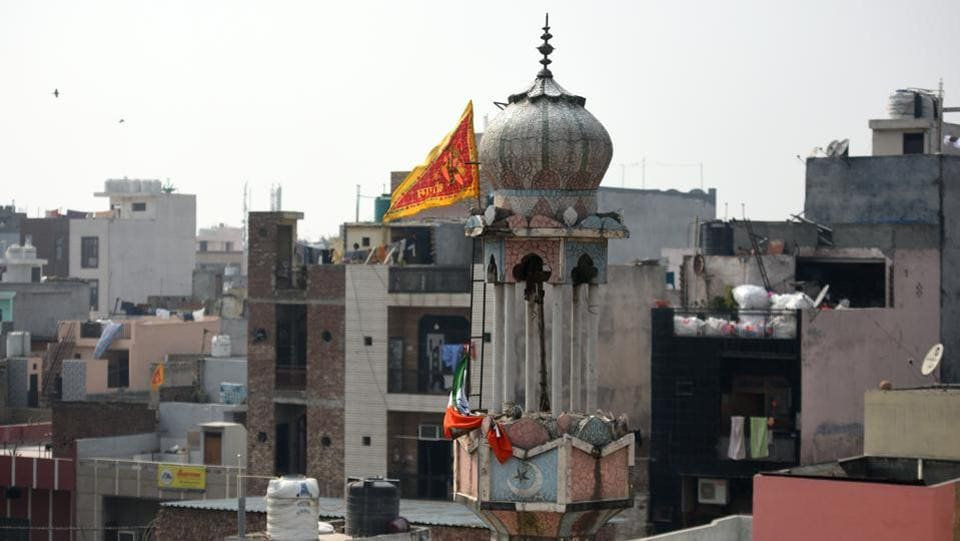 A view of the Badi Masjid that was burnt by miscreants during clashes over the new citizenship law, at Ashok Nagar,  on  February 26. A flag with a Hindu religious deity was mounted atop the Masjid. (Amal KS / HT Photo)