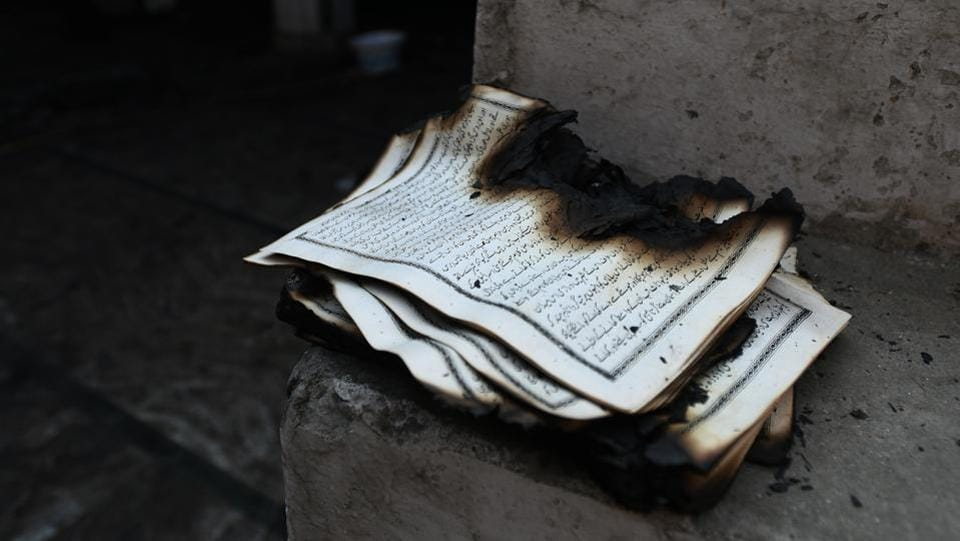 A burnt book found inside a mosque that was gutted in the  fire at Brijpuri, Mustafabad on  February 26. (Biplov Bhuyan / HT Photo)