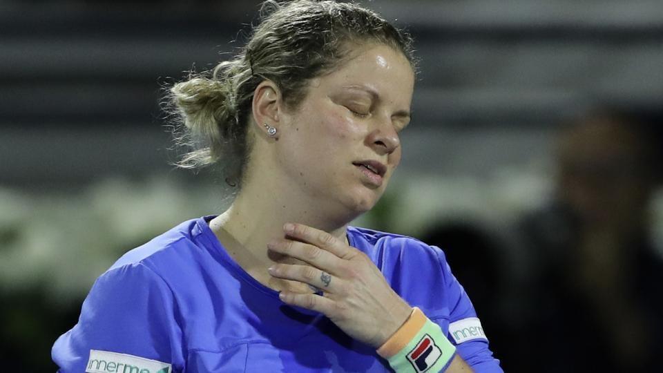 Belgium's Kim Clijsters reacts in a match against Spain's Gabrine Muguruza.