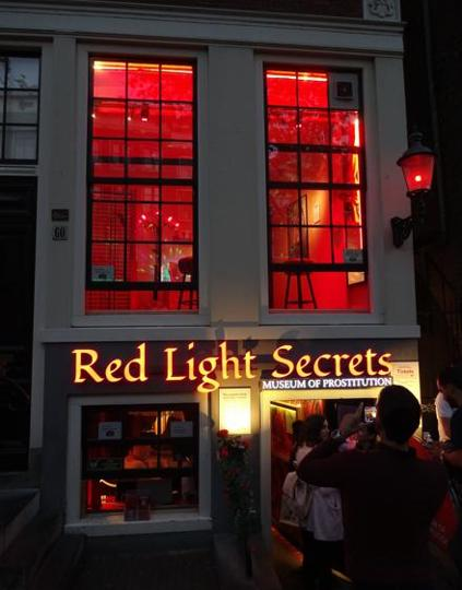 The street-facing windows of the Red Light Secrets museum in Amsterdam.