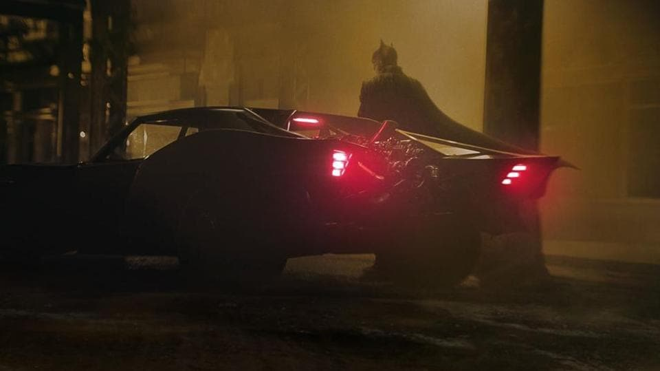 The Batman : Robert Pattinson poses with his sleek new Batmobile , fans are still feeling Affleck hangover