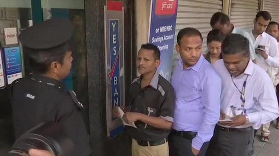 Yes Bank customers queue up outside the Fort branch on Friday morning.
