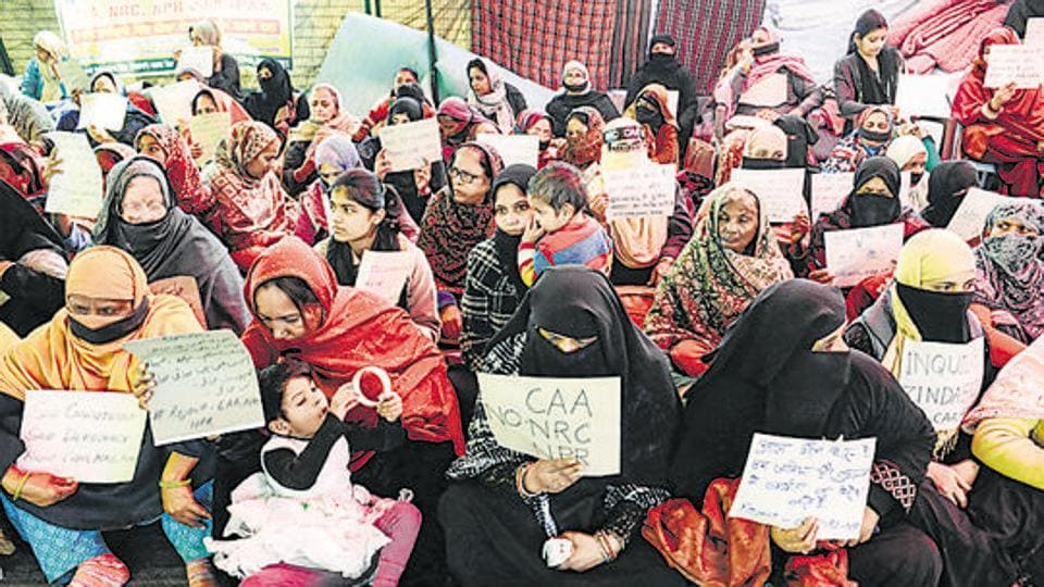 Women and children hold placards during a silent protest against the CAA and the NRC, Shaheen Bagh, New Delhi, February 11