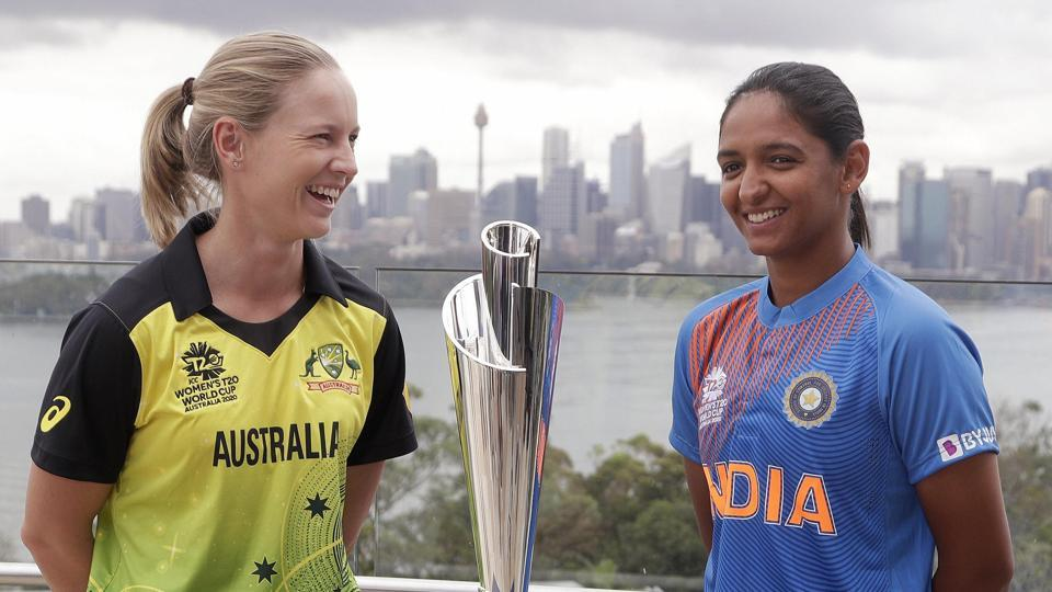 Sydney: Cricket captains Meg Lanning of Australia, left, and Harmanpreet Kaur of India pose for a photo with the trophy ahead of the Women's T20 World Cup.