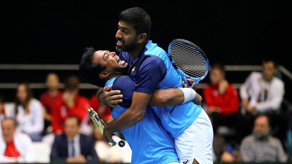 India's Rohan Bopanna and Leander Paes celebrate after winning the match.