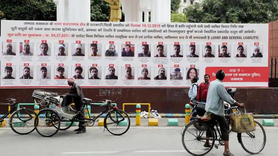 Lucknow administration put up hoardings with photographs, names, and addresses of 57 people who have been issued recovery notice for their alleged involvement in violence during Anti CAA protest in Lucknow on Friday.