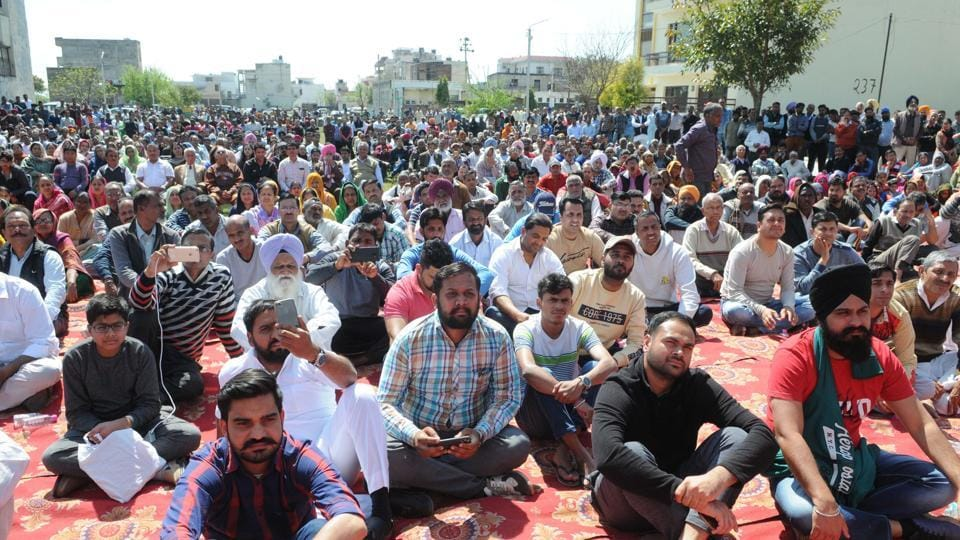 Residents of areas that face demolitions following the Punjab and Haryana high court's order attending a meeting in Kansal on Sunday. Around 2,000 families are expected to be affected in Kansal alone.