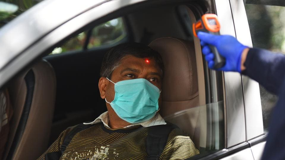 A woman goes through thermal screening amid the coronavirus scare with 43 cases tested positive in India so far, in New Delhi on Monday.
