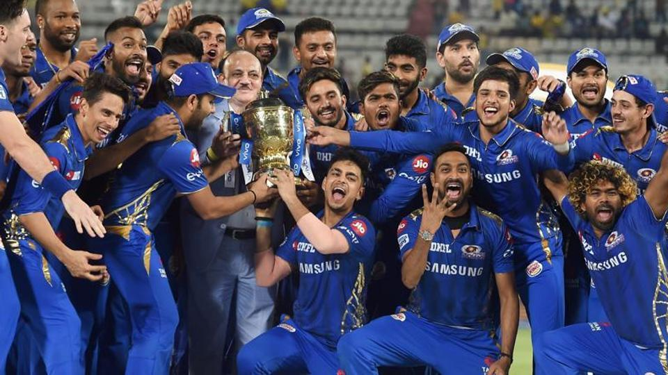 Mumbai Indians (MI) skipper Rohit Sharma with his teammates celebrating with Indian Premier League 2019 winning trophy after win over Chennai Super Kings (CSK) at the Final cricket match at Rajiv Gandhi International Cricket Stadium in Hyderabad.