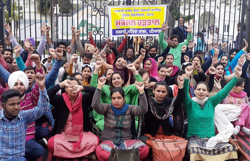 Members of the Guest Faculty Assistant Professors' Association protesting outside the Government Mohindra College in Patiala on Wednesday.